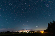 PERSEID METEORS: I got to see about a dozen last night (early morning 8/11) in almost 2 hours. The meteors we'll see burn up in the night sky were released from Swift-Tuttle comet back in 1862! Some I couldn't see until I looked at my images on computer. I like this with the Big Dipper, which was super bright too, and clouds. I'll try again tonight at 0200 and hope it's clear, maybe going to the waterfront. I think some experts stack their images to get multiple meteors in one shot, or do multi-exposures. But at 40 secs per shot (with NR) the sky moves relative to the landscape.<br />