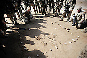 Quick reaction force looking at an attack plan during a drill in the mountains close to Mazar e Sharif.<br /> For more caption info, please contact photographer.