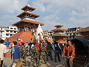 Soldiers march through Durbar Square, Kathmandu, Nepal, Asia. Dasain Festival (or Durga Puja) is Nepal's biggest annual festival, a 15-day family affair with the biggest animal sacrifice of the year. Durga Puja celebrates the victory of the bloodthirsty goddess Durga over the forces of evil personified in the buffalo demon Mahisasura.  Outside of the city, country dwellers erect swings and makeshift ferris wheels.