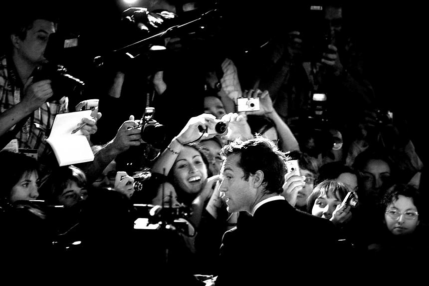 British actor Jude Law signs autograph upon his arrival to the premiere of his latest movie Sleuth directed by Kenneth Branagh, in competition at the 64th edition of the Venice film festival