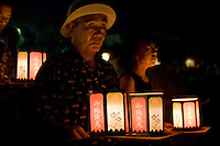 "August Obon celebrations culminate with Toro Nagashi ""the floating of lanterns"" - paper lanterns are illuminated  then floated down rivers or on the ocean signaling the ancestral spirits' return to the world of the dead."