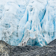 "People are dwarfed by the Exit Glacier, which flows from the Harding Icefield in the Kenai Mountains of Alaska, USA. The only road into Kenai Fjords National Park is a spur of the Seward Highway to Exit Glacier, one of the most visited glaciers in Alaska. It was named after the exit of the first recorded crossing of Harding Icefield in 1968. Hike trails to the glacier terminus or up to Harding Icefield. From 1815-1999, the Exit Glacier in Alaska retreated 6549 feet, melting an average of 35 feet per year (according to www.nps.gov/kefj/). Over the past 50 years, Alaska's winters have warmed by 6.3°F (3.5°C) and its annual average temperature has increased 3.4°F (2.0°C) (Karl et al. 2009). Alaska has warmed more than twice as fast as the continental United States. Since the industrial revolution began, humans have increased atmospheric carbon dioxide concentration by 35% through burning fossil fuels, deforesting land, and grazing livestock. An overwhelming consensus of climate scientists agree that global warming is indeed happening and humans are contributing to it through emission of greenhouse gases (primarily carbon dioxide). The UN Intergovernmental Panel on Climate Change (IPCC, 2007) says ""Warming of the climate system is unequivocal, as is now evident from observations of increases in global average air and ocean temperatures, widespread melting of snow and ice and rising global average sea level. There is very high confidence that the net effect of human activities since 1750 has been one of warming."""