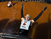 """A participant heads backwards towards the water while making his way through the """"Sewage Outlet"""" obstacle during the World's Toughest Mudder about Lake Las Vegas on Saturday, November 15, 2014. L.E. Baskow"""
