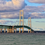 Majestic Mackinac&quot;<br /> <br /> A lovely view of the majestic Mackinac Bridge. The longest suspension bridge in Michigan. Beautiful clouds and sunshine complete this wonderful image!!<br /> <br /> Mackinac Bridge by Rachel Cohen
