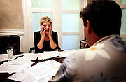 Kathy Coleman goes over paperwork with her attorney as she tries to save her home in Ave Maria. Coleman, a former conference director for Legatus, a high profile Catholic business organization, made about $74,000 a year, before being let go from her position. Even with two part time jobs, one at a real estate office and the other as a deli slicer at Publix, Coleman still couldn't make the payments on her house. Greg Kahn/Staff
