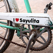 "SHOT 2/10/09 4:25:54 PM - A bike displaying its owners feelings for Sayulita, Mexico. Sayulita is a small fishing village about 25 miles north of downtown Puerto Vallarta in the state of Nayarit, Mexico. Known for its consistent river mouth surf break, roving surfers ""discovered"" Sayulita in the late 60's with the construction of Mexican Highway 200. Today, Sayulita is a prosperous growing village of approximately 4,000 residents. Hailed as a popular off-the-beaten-path travel destination, Sayulita offers a variety of activities such as horseback riding, hiking, jungle canopy tours, snorkeling and fishing. Still a mecca for beginner surfers of all ages, the quaint town attracts upscale tourists with its numerous art galleries and restaurants as well. Sayulita has a curious eclectic quality, frequented by native Cora and Huichol peoples, travelling craftsmen as well as international tourists. Sayulita is the crown jewel in the newly designated ""Riviera Nayarit"", the coastal corridor from Litibu to San Blas. It's stunning natural beauty and easy access to Puerto Vallarta have made Sayulita real estate some of the most sought after in all of Mexico..(Photo by Marc Piscotty / © 2009)"