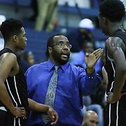 Appoquinimink Head Coach Steve Wright, center, provides instructions to Appoquinimink Guard MYLES CALE (3) in the course of a time out in the second half of a regular season basketball game between St. Georges Tech and Appoquinimink Monday, Feb. 22, 2016, at St. Georges Tech in Middletown.