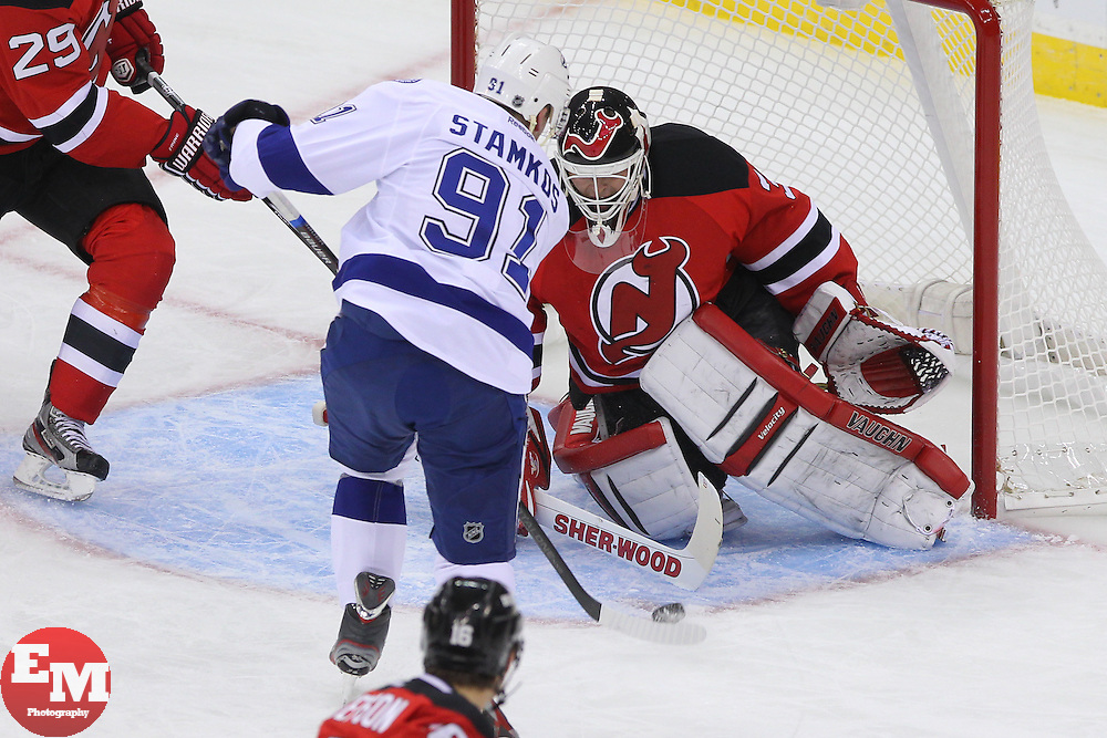 Feb 7, 2013; Newark, NJ, USA; New Jersey Devils goalie Martin Brodeur (30) makes a save on Tampa Bay Lightning center Steven Stamkos (91) during the first period at the Prudential Center.