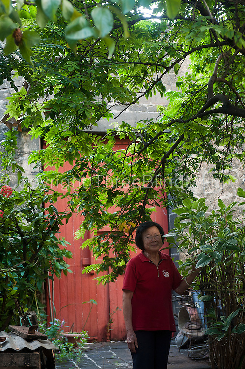 Mrs. Ven Pin in her house and lovely garden in Chinatown.