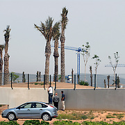 Murcia, Spain. From a story on the explosion of controversial golf resorts in Spain's arid south-east. These walled developments are often built on former farming land when farmers sell their land to the big developers. Most of these new houses are sold to foreign buyers as holiday homes..Photo shows prospective buyers near the Polaris World La Torre Golf Resort which is under construction in Murcia, Spain..Photo©Steve Forrest/Amaya Roman