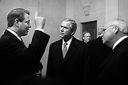 Vice-President Al Gore makes a point to George W. Bush and Dick Cheney in a holding room inside the Capitol before the Inaugural.