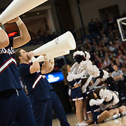 Cheerleaders rally the crowd during a game in the Kennel.