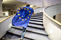 Supporter of EPP group candidate designate vying for the presidency of the European Commission Jean-Claude Juncker  runs  with European flag  during   the election night at European Parliament headquarters in Brussels, Belgium on 25.05.2014 The European elections, which run from 22 to 25 May, will form a new European Parliament, whose 751 members will help set laws in the European Union for five years to come. About 400 million people in the 28-country bloc are eligible to vote.  by Wiktor Dabkowski