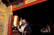 On the pilgrims way there are hundreds of prayer wheels to turn..LAMBRANG MONASTERY IN XIAHE - CHINA.copyright: Androniki Christodoulou.