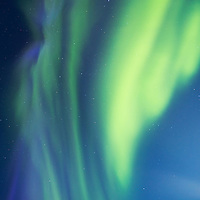 Canada, Nunavut Territory, Arviat, Northern lights, aurora borealis in night sky above west coast of Hudson Bay at Sentry Island