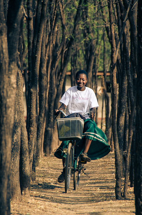 A Forgirlsake sponsored student rides her bicycle home from school.