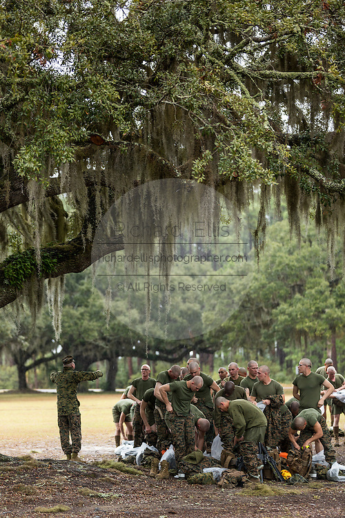 US Marine recruits change out of contaminated clothing after gas chamber training as a drill instructor shouts commands during bootcamp January 13, 2014 in Parris Island, SC.