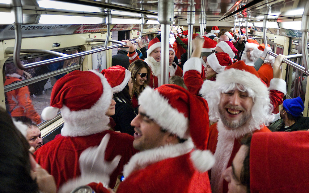 SantaCon New York City 2010..The annual Santa Convention held in New York City. Thousands of people dress up as Santa Claus and venture through New York City, stopping at bars throughout the day and night.