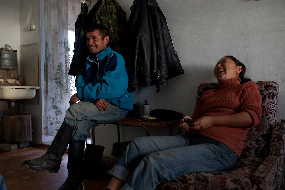 CREDIT: DOMINIC BRACCO II..SLUG:PRJ/KAZAKHSTAN SHEEP HERDERS..DATE:10/23/2009..CAPTION:From left, husband and wife Zhumatai Muzdybayev and Madina Manasbayeva enjoy a break from the cold at their home. The herders live near a radio active lake which was made during the 1970s as part of an experiment by the USSR to create lakes from atomic bombs. The lake is in an area known as The Polygon, a test site for more than 400 of the Soviet Union's nuclear weapons.