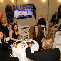 Patrons can take in some NCAA Final Four action or just chat in the sports lounge during the 14th Annual ArtsGala at Wright State University's Creative Arts Center, Saturday, April 6, 2013.
