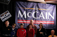 Supporters listen as Republican presidential candidate U.S. Senator John McCain speaks to supporters during a campaign stop in Aiken, South Carolina January 17, 2008.