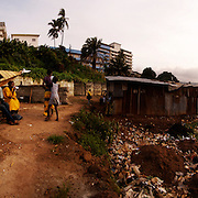 Boat builder, Kroo Bay, Freetown, Sierra Leone.