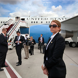 Brittany Cross keeps watch while working as part of Hillary Clinton's security detail in the United Arab Emirates, Jan. 11, 2011.
