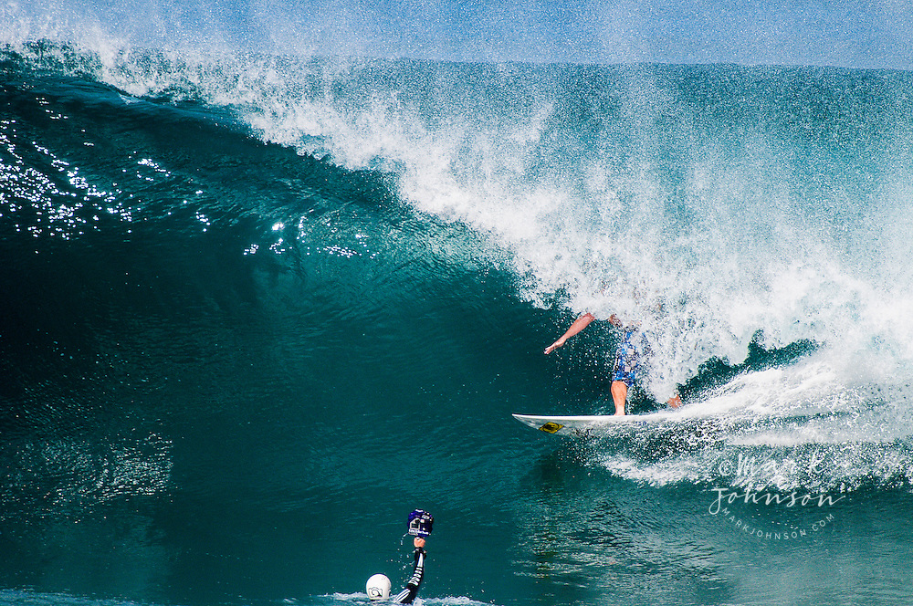 Water photographer taking a photo of a surfer at Backdoor Pipeline, North Shore, Oahu, Hawaii
