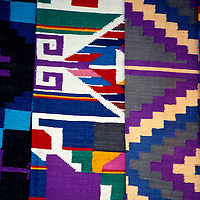 Central America, Guatemala, Antigua. Colorful woven textiles of Guatemala.