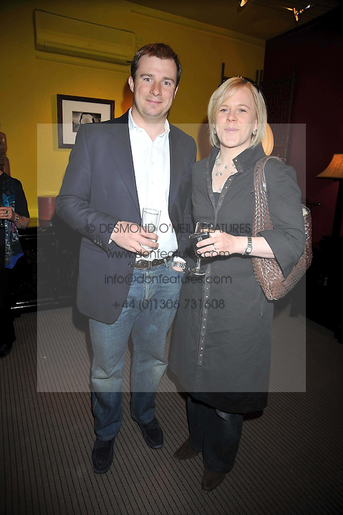 GUY & LOTTIE BOSTOCK at a party to celebrate the publication of Joth Shakerley's book 'Pregnant Women' held at 598a Kings Road, London SW6 on 20th May 2009.