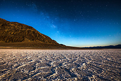 """""""Badwater Basin at Night 1"""" - Predawn photograph of the Badwater Basin salt flat in Death Valley, California. The Milky Way can be seen in the sky."""
