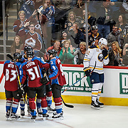 SHOT 2/25/17 8:37:51 PM - The Buffalo Sabres' Marcus Foligno #82 reacts as the Colorado Avalanche celebrate a goal during their NHL regular season game at the Pepsi Center in Denver, Co. The Avalanche won the game 5-3. (Photo by Marc Piscotty / © 2017)