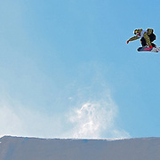"""SHOT 1/25/08 2:54:27 PM - Norwegian snowboarder Andreas Wiig from Oslo gets airborne over the """"money booter"""" jump during qualifying for the Snowboard Slopestyle event Friday January 25, 2008 at Winter X Games Twelve in Aspen, Co. at Buttermilk Mountain. Wiig qualified for the event and went on to win with a score of 92.00, beating out U.S. riders Kevin Pearce (88.33) and Shaun White (83.33). It was the second year in a row Wiig has won gold in the event. The 12th annual winter action sports competition features athletes from across the globe competing for medals and prize money is skiing, snowboarding and snowmobile. Numerous events were broadcast live and seen in more than 120 countries. The event will remain in Aspen, Co. through 2010..(Photo by Marc Piscotty / WpN © 2008)"""