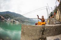 Sadhuji meditating at the Ganga, in front of Ram Jula