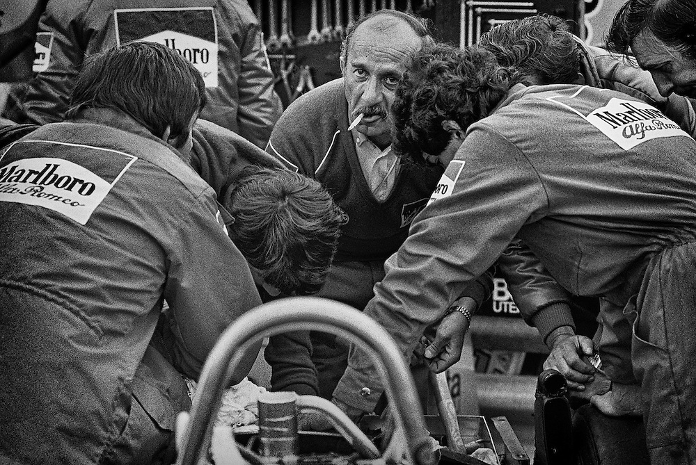 Marlboro Alfa Romeo race engineer Ermanno Cuoghi&rsquo;s face betrays a seemingly hopeless cause as he leads his team of mechanics trying to solve a transmission malfunction within minutes of the start of the 1982 Detroit Grand Prix. <br />