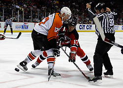 Mar 30, 2007; East Rutherford, NJ, USA; New Jersey Devils right wing Michael Rupp (17) and Philadelphia Flyers center Jeff Carter (17) face off during the third period at Continental Airlines Arena in East Rutherford, NJ.