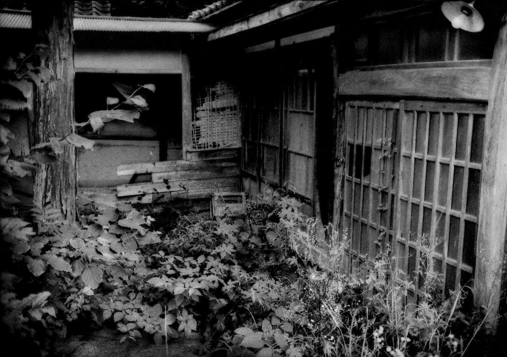 A traditional house in the evacuated village of Tsushima that has been broken into.  Burglary is a big problem in the irradiated villages where villagers were forced to abandoned due to nuclear fallout.  Tsushima, Namie-machi, Fukushima Prefecture, Japan.