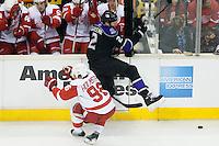 Matt Greene (Los Angeles Kings, #2) hits Tomas Holmstrom (Detroit Red Wings, #96) during ice-hockey match between Los Angeles Kings and Detroit Red Wings in NHL league, February 28, 2011 at Staples Center, Los Angeles, USA. (Photo By Matic Klansek Velej / Sportida.com)