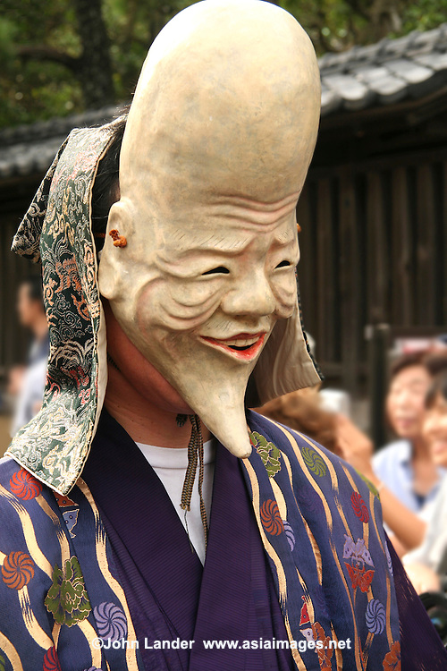 Bald Mengake Mask at the Mengake Mask Parade at Goryo Jinja shrine.  At this unique Kamakura event local men wearing grotesque or comical masks leave Goshi Shrine parade through the nearby streets before returning to the shrine for the ceremony.