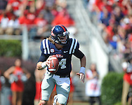 Ole Miss quarterback Bo Wallace (14) vs. Auburn at Vaught-Hemingway Stadium in Oxford, Miss. on Saturday, October 13, 2012. (AP Photo/Oxford Eagle, Bruce Newman)..