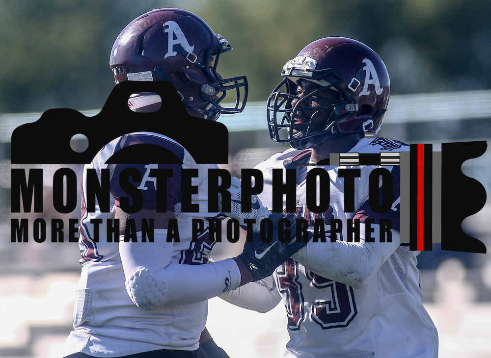 Appoquinimink Running back Ronald Tuck (35) confronts  defensive linemen Christopher Saunders (23) in the fourth quarter Saturday, Oct. 10, 2015 at Bill Cole Stadium in New Castle, DE.