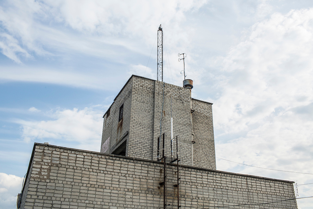 AVDIIVKA, UKRAINE - JULY 9, 2016: A camera that is used by the OSCE monitoring mission is mounted on a tower atop a nine-story building near the front lines to observe ceasefire violations in Avdiivka, Ukraine. The mission tracks violations of the Minsk-II ceasefire agreement, among other tasks. CREDIT: Brendan Hoffman for The New York Times
