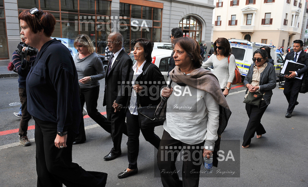 CAPE TOWN, SOUTH AFRICA - Wednesday 8 October 2014, Prakash Dewani and his wife (parents of Shrien Dewani) leave court after proceedings during Day 2 of the Shrien Dewani trial at the Cape High Court before Judge Jeanette Traverso. Dewani is caused of hiring hit men to murder his wife, Anni. Anni Ninna Dewani (n&eacute;e Hindocha; 12 March 1982 &ndash; 13 November 2010) was a Swedish woman who, while on her honeymoon in South Africa, was kidnapped and then murdered in Gugulethu township near Cape Town on 13 November 2010 (wikipedia).<br /> Photo by Roger Sedres