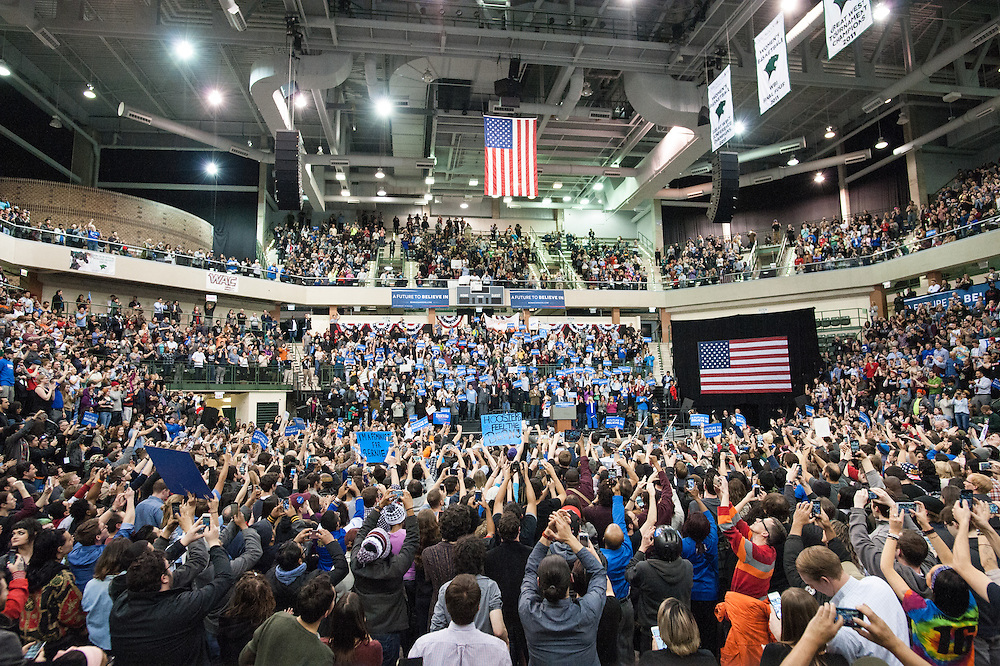 Thousands cheer as democratic presidential candidate Sen. Bernie Sanders enters a rally at the Jones Convocation Center at Chicago State University in Chicago on Thursday, Feb. 25, 2016.