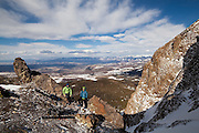 Backcountry skiers Sterling Roop (left) and Judd MacRae at the top of a couloir below Hayden Peak, San Juan Mountains, Colorado.