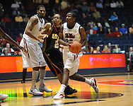 "Ole Miss' Jarvis Summers (32) vs. Grambling State's Bryant Purvis (11) during the first half at the C.M. ""Tad"" Smith Coliseum in Oxford, Miss. on Monday, November 14, 2011.."