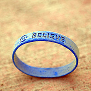 """A Chicago Cubs """"Believe"""" bracelett can still be found on the ground outside the stadium as a reminder of spring training."""