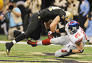 New Orleans Saints linebacker Will Herring intercepts a pass to New York Giants' Jake ballard (85) at the Superdome in New Orleans, La. on Monday, November 28, 2011. New Orleans won 49-24.
