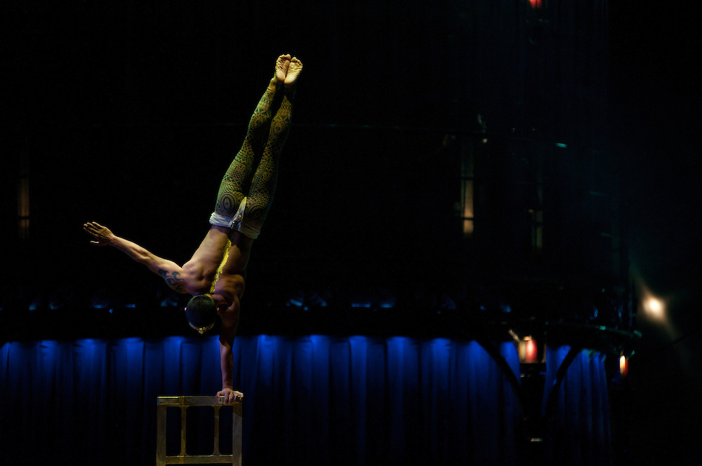 London, UK - 4 January 2012: Acrobat perform a balancing act on a chair tower during the Cirque Du Soleil Kooza dress rehearsal at the Royal Albert Hall. Since its premiere in April of ..2007, KOOZA has captivated close to four million spectators in North America and Japan.  London will be the first destination of the KOOZA European tour starting the ..5th of January. Written and directed by David Shiner, KOOZA is a return to the origins of Cirque du Soleil combining two circus traditions - acrobatic performance and ..the art of clowning.  KOOZA highlights the physical demands of human performance in all its splendor and fragility, presented in a colorful m&eacute;lange that emphasizes ..bold slapstick humor. This image can be quickly and easily purchased from some of the major international stock agencies:<br /> <br /> Alamy Images, following this link:<br /> http://tinyurl.com/avb24d4<br /> <br /> Demotix, following this link: <br /> http://tinyurl.com/a3mscez<br /> <br /> Barcroft, following this link:<br /> http://tinyurl.com/a6tkquz