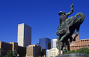 Image of the Bucking Broncho statue at the Civic Center Park, with downtown buildings in Denver, Colorado, American Southwest
